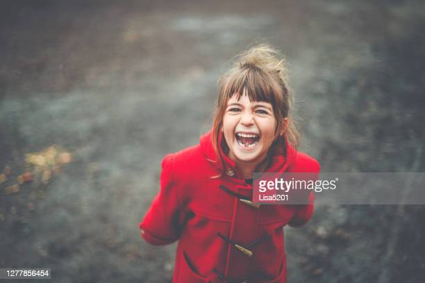 little brat girl screaming and having a tantrum - rebellion stock pictures, royalty-free photos & images