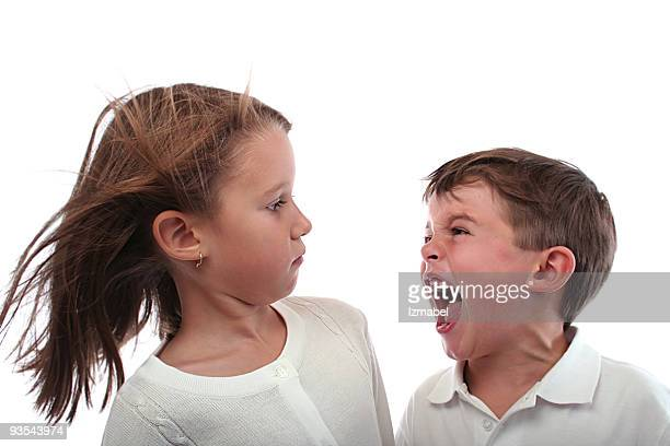 little brother screaming at her older sister. - single word stock pictures, royalty-free photos & images