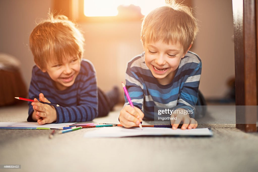 Little brothers enjoying drawing together : Stock Photo