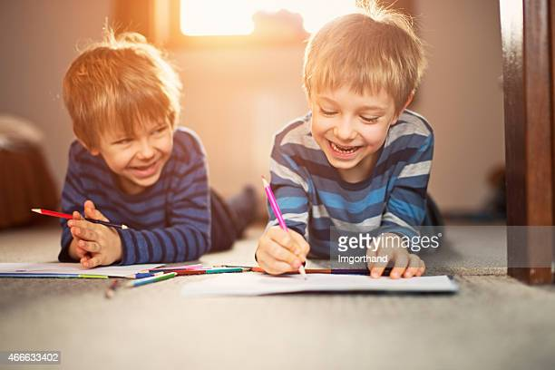 little brothers enjoying drawing together - colouring stock photos and pictures