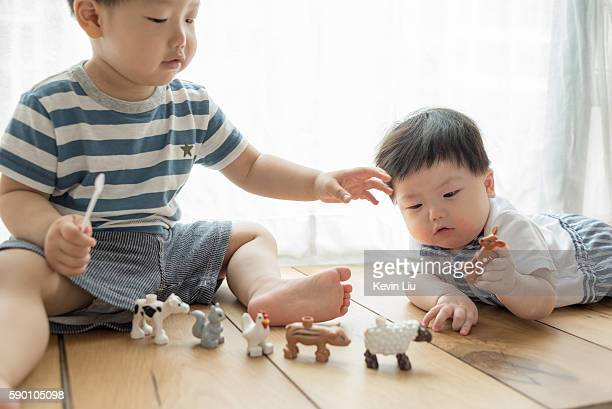 Little brothers playing on floor