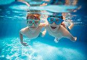 Little brothers swinning underwater together