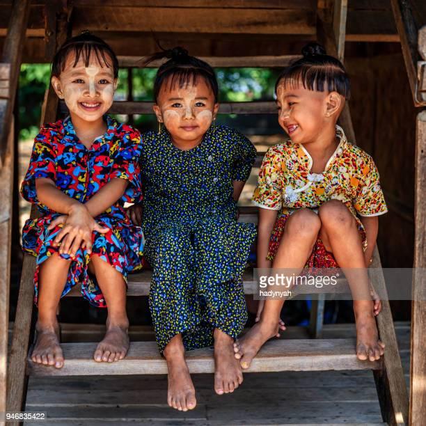 little burmese girls  in village near bagan, myanmar - myanmar stock pictures, royalty-free photos & images