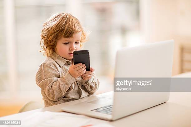 little business boy using smart phone in the office. - adult imitation stock pictures, royalty-free photos & images