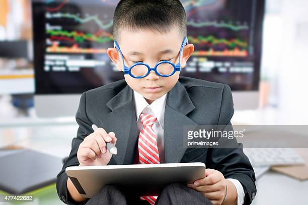 Little bussiness boy with tablet