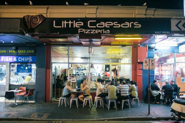 little caesars pizza shop full of customers, in Perth Australia