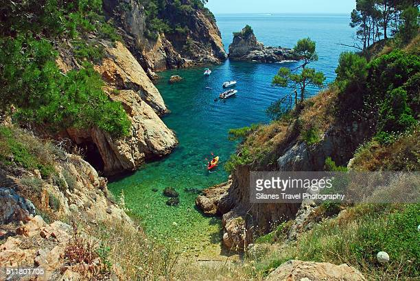 little cala near platja de castell palamos girona - girona stock photos and pictures