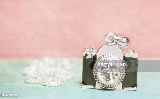 little camera charm necklace - charm bracelet stock photos and pictures