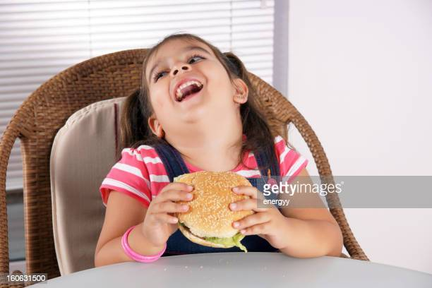 little caucasian girl eating burger (XXXLarge)