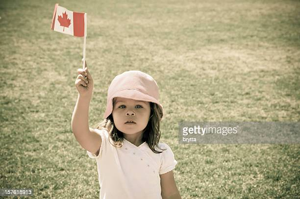 Little caucasian girl with flag proud to be Canadian