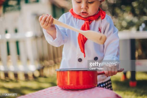 little chef cooking outdoors - carol cook stock pictures, royalty-free photos & images