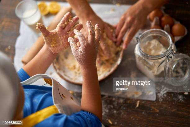 little chef is at kitchen - domestic kitchen stock pictures, royalty-free photos & images