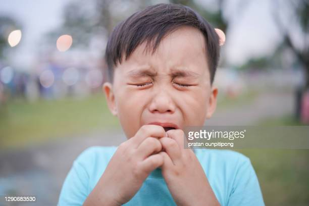 little child crying with eyes close - bad student stock pictures, royalty-free photos & images