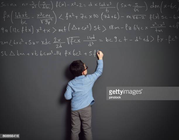 little child in front of huge blackboard - chalkboard stock photos and pictures