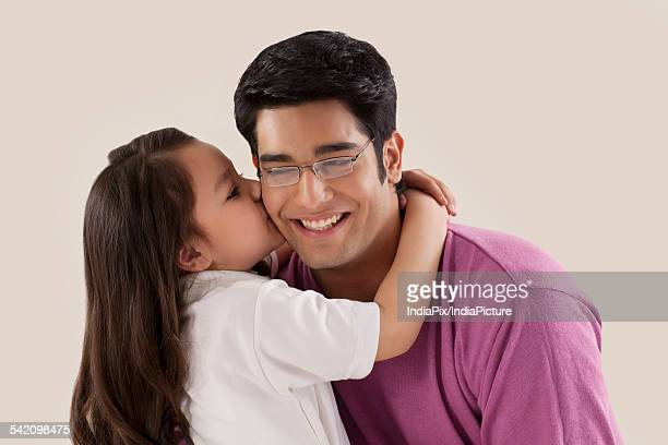 little child kissing her father - indian girl kissing stock photos and pictures