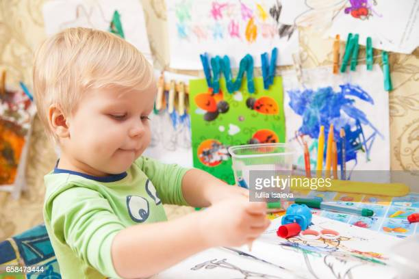 little child making paintings - colouring stock photos and pictures