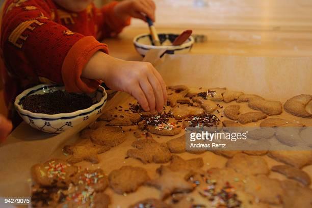 A little child making sugar cookies at a kindergarten of the Rudolf Steiner Waldorfschule on December 11 2009 in Berlin Germany Each year Berlin's...