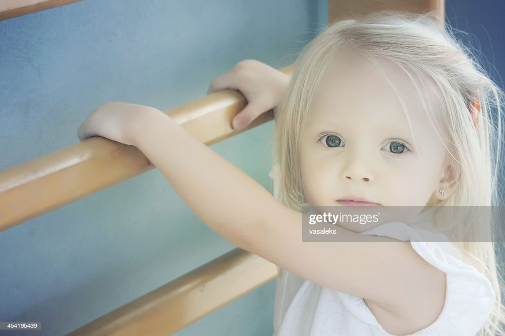 little child playing sports and climbing the stairs : Stock Photo