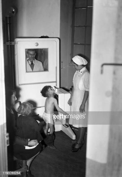 A little child undergoes an xray radiography of the lungs during a tuberculosis screening operation on April 23 1945 in Montreuil