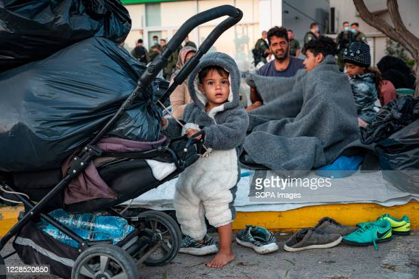 Little children are among the refugees sleeping on roadside after Moria fire. More than 13,000 Asylum seekers flee fire at Greece's largest migrant...