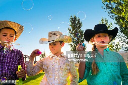 Little Children Blowing Bubbles