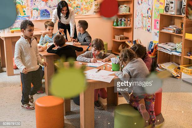 little children having an art class in a preschool. - nursery school building stock pictures, royalty-free photos & images