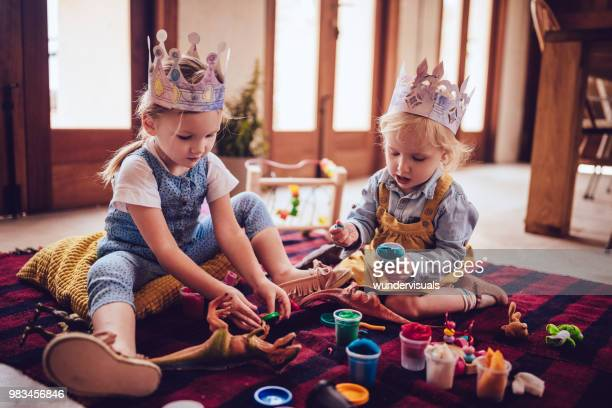 little children having fun playing with play dough at home - clay stock pictures, royalty-free photos & images