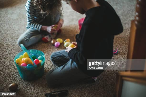 Little Children opening up plastic Easter eggs