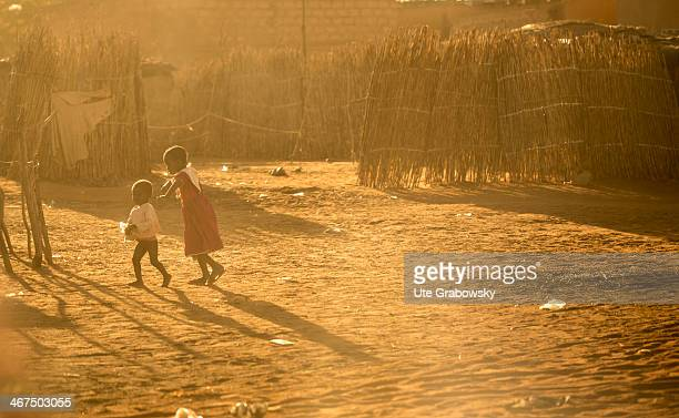 Little children playing on a dusty street in the Nigerian capital Niamey on December 07 in Niamey Niger Photo by Ute Grabowsky/Photothek via Getty...