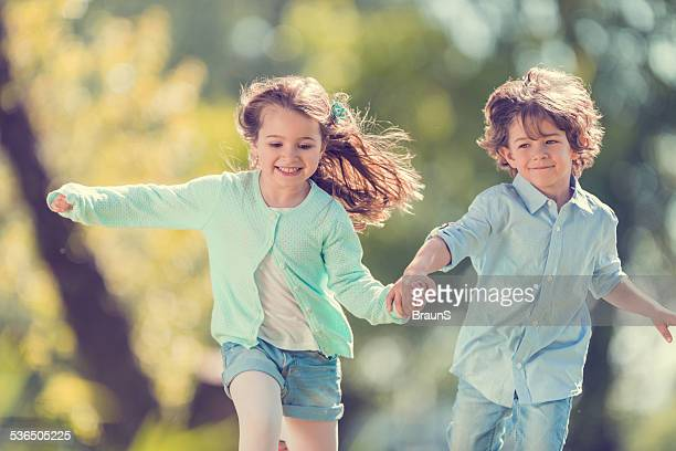 Little children running in the park.