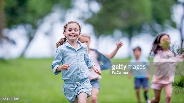 little niños correr al aire libre - kids playing tag fotografías e imágenes de stock