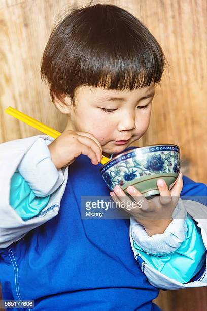 Little chinese dong people girl eating at home