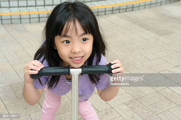 Little Chinese Girl with Push Scooter, Hong Kong Park, Asia