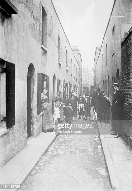 Little Collingwood Street Bethnal Green London 1900s Residents of the street pose for the photographer Two of the boys in the front of the picture...
