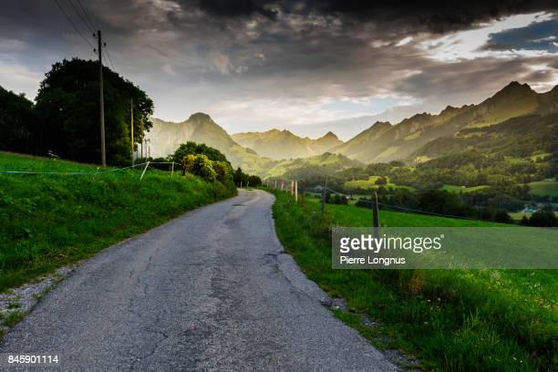Little country road in the mountains of the Gruyere region, Swiss Alps, Switzerland