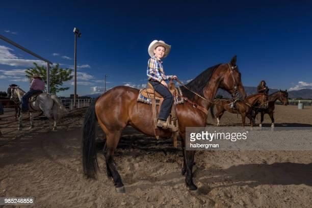Little Cowboy on Horseback in Rodeo Arena