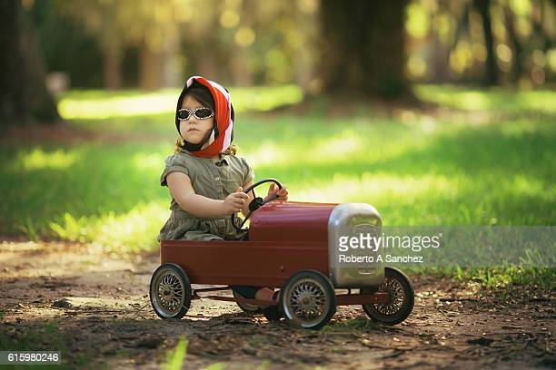 Little cuban girl driving car