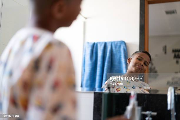 little cut kid looking to the mirror at morning - looking stock pictures, royalty-free photos & images