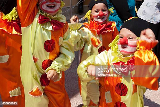 little cute clowns - school play stock photos and pictures