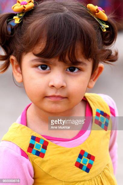 little cute girl looking at the camera - punjabi girls images stock photos and pictures
