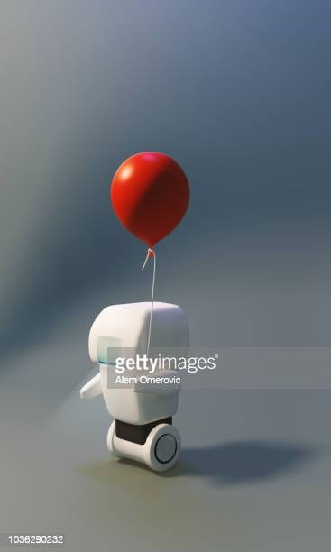little cute white robot holding red baloon. - futurism stock photos and pictures
