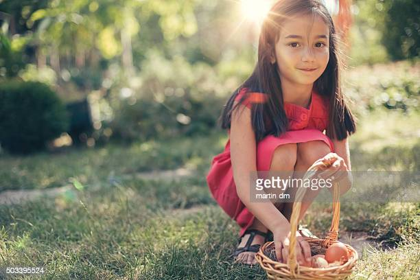 little cutie gathering eggs - petite teen girl stock photos and pictures