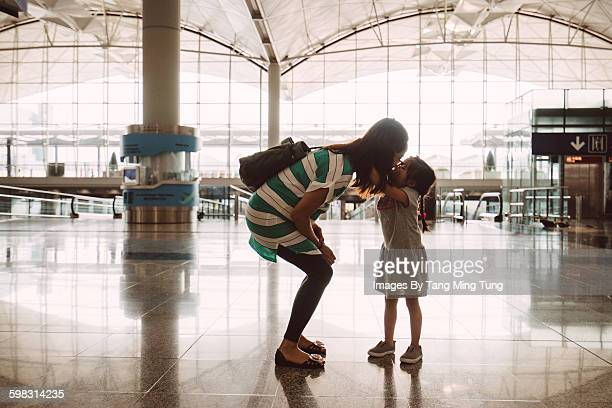 Little daughter kissing goodbye at the airport