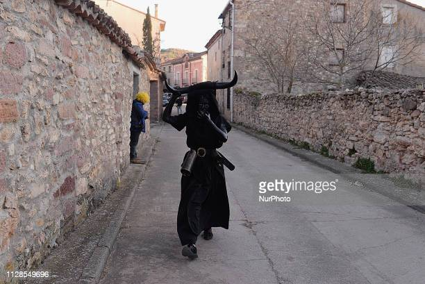 A little devil in Luzon's Carnival during an ancient Carnival in Guadalajara Spain on 2nd March 2019 The Devils of Luzón that carry antlers of bull...