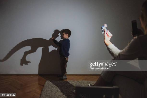 little dinosaur lover - shadow puppet stock photos and pictures