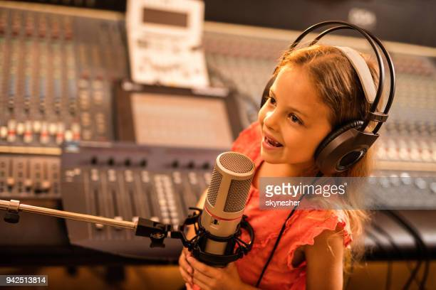 little dj having a radio broadcast from a radio station. - radio broadcasting stock pictures, royalty-free photos & images