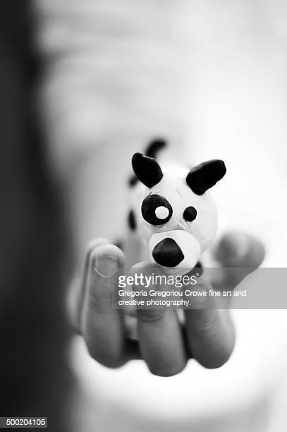 little doggy in her palm - gregoria gregoriou crowe fine art and creative photography. stock pictures, royalty-free photos & images
