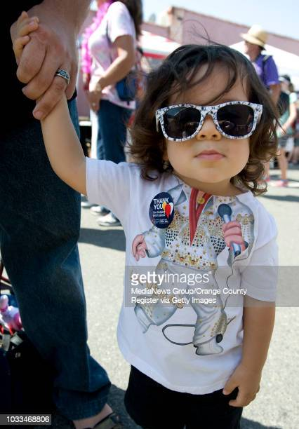 """Little Elvis, Xander Ceja listens to Elvis impersonators during the ÒThe King Lives On"""" Elvis festival on Sunday in Garden Grove. He was with his..."""
