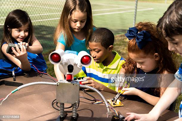 Little engineers!  Elementary children collaborate on 'robot' they created.