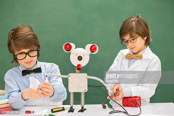 Little engineers! Elementary-age children collaborate on 'robot' creation.